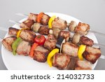on a white plate kebab  fried... | Shutterstock . vector #214032733