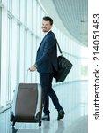 business traveler pulling...   Shutterstock . vector #214051483
