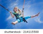 Happy Little Girl Flying Over...