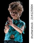 Portrait of burnt little boy with cigarette butt holding up his hand to say stop, over black background - stock photo