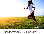 runner athlete running on grass ... | Shutterstock . vector #214281913