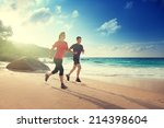 man and woman running on... | Shutterstock . vector #214398604