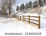 Split Rail Fence Along A Snowy...