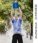 Young Man Pouring Ice Water...
