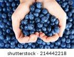 female hands holding tasty ripe ... | Shutterstock . vector #214442218