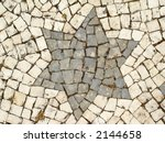a star on a stone pavement... | Shutterstock . vector #2144658
