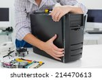 young technician working on... | Shutterstock . vector #214470613
