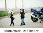 Cute Little Biker On Road With...