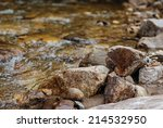 Stones On The Shore Of A River