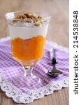 Small photo of A La carte dessert orange color with cream and nuts