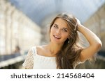 beautiful young woman in white... | Shutterstock . vector #214568404