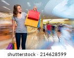 young happy girl with shopping... | Shutterstock . vector #214628599