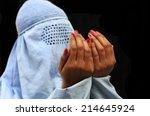 muslim women praying  | Shutterstock . vector #214645924