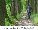 Stock photo man and dog walking on park 214654243