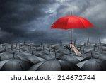 red umbrella in mass of black... | Shutterstock . vector #214672744