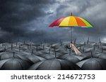 rainbow umbrella in mass of... | Shutterstock . vector #214672753