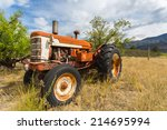 Old Abandoned Tractor In Grass...