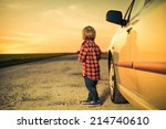 little boy near car at rural... | Shutterstock . vector #214740610