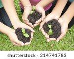 hands holding sapling in soil... | Shutterstock . vector #214741783