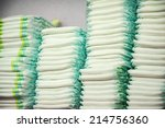 diapers stacked in a piles in... | Shutterstock . vector #214756360
