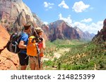hiking   hikers looking at view ... | Shutterstock . vector #214825399
