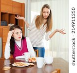two sad women having conflict... | Shutterstock . vector #214911250