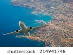 Passenger Airplane Flying Abov...