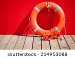 Lifebuoy Stands On Wooden Floo...