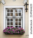 old house window with flowers | Shutterstock . vector #214964620