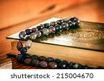 holly quran with beads | Shutterstock . vector #215004670