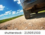Small photo of Car tires on gravel goad