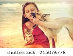 Stock photo child and dog and cat on the beach 215076778