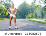 young sport woman standing in... | Shutterstock . vector #215083678