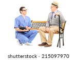 young doctor talking to a... | Shutterstock . vector #215097970