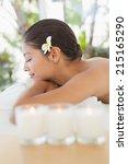 beautiful brunette relaxing on...   Shutterstock . vector #215165290