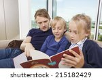 father and children reading...   Shutterstock . vector #215182429