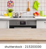 Wooden Table On Blurred Kitche...