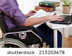 young disabled man studying at... | Shutterstock . vector #215203678