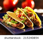 three beef tacos with cheese ... | Shutterstock . vector #215240854