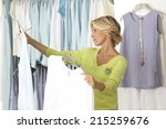 mature woman shopping in... | Shutterstock . vector #215259676