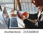 businessman using smartphone... | Shutterstock . vector #215260810