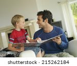 father and son  5 7  looking at ... | Shutterstock . vector #215262184