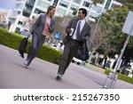 businessman and businesswoman... | Shutterstock . vector #215267350