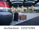 luggage beside parked car... | Shutterstock . vector #215271583