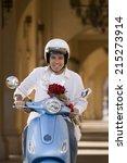 man riding on motor scooter... | Shutterstock . vector #215273914