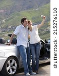 couple standing beside parked... | Shutterstock . vector #215276110
