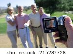 man filming two mature couples... | Shutterstock . vector #215282728