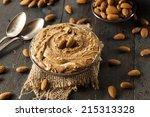 raw organic almond butter on a...   Shutterstock . vector #215313328