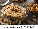 raw organic almond butter on a... | Shutterstock . vector #215313460