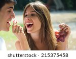 portrait of young couple eating ... | Shutterstock . vector #215375458